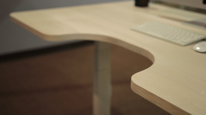 The curved cutout allows for arm rests whether you're sitting or standing