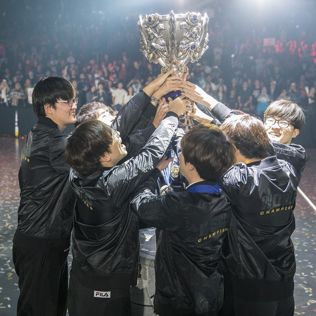 SK Telecom T1 hoisting their third Summoner's Cup - courtesy of LoLEsports