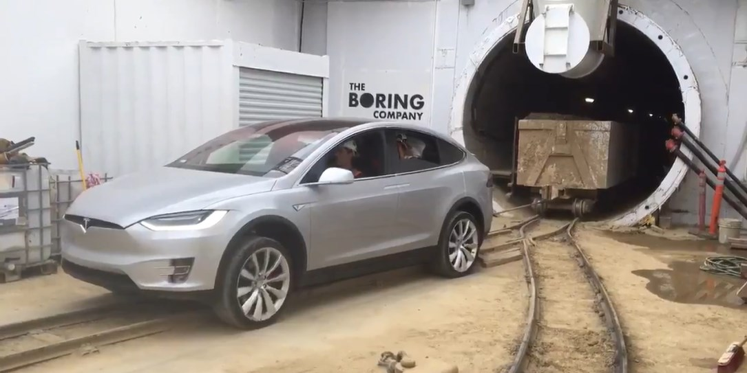 Tesla sitting near a The Boring Company tunnel