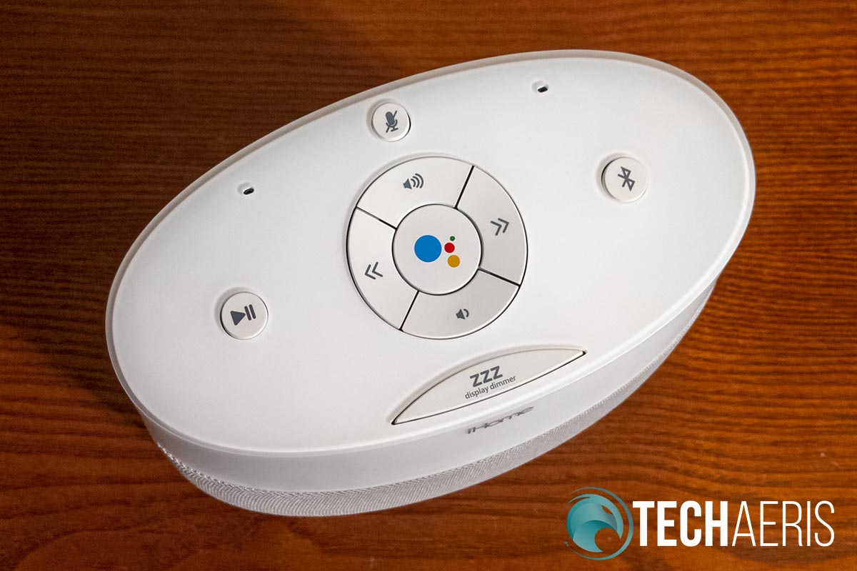 Physical buttons on the top of the iHome iGV1 Google Assistant Built-In Bedside Speaker System.