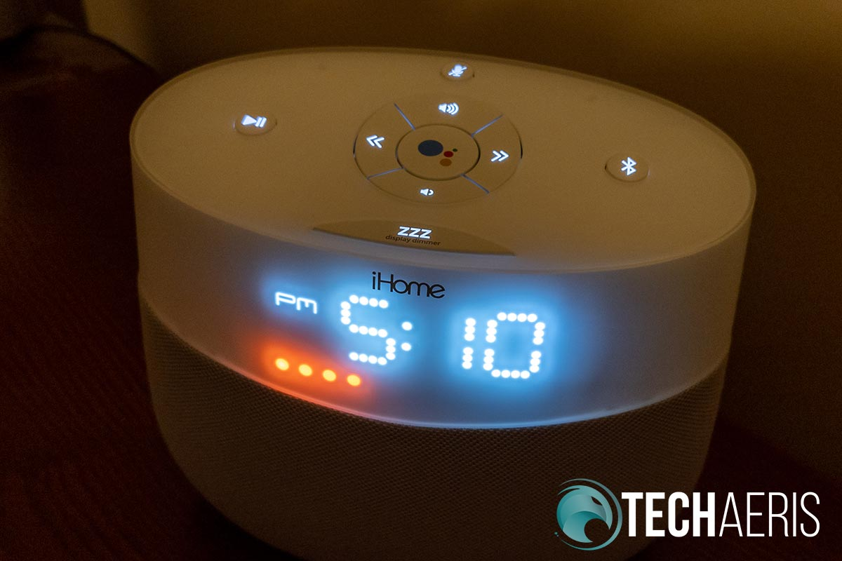 Physical buttons on the top of the iHome iGV1 Google Assistant Built-In Bedside Speaker System with mute LEDs visible.