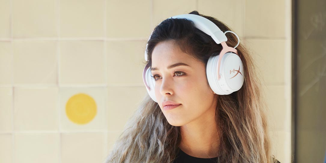 Woman wearing HyperX Cloud MIX Rose Gold wired/Bluetooth headset