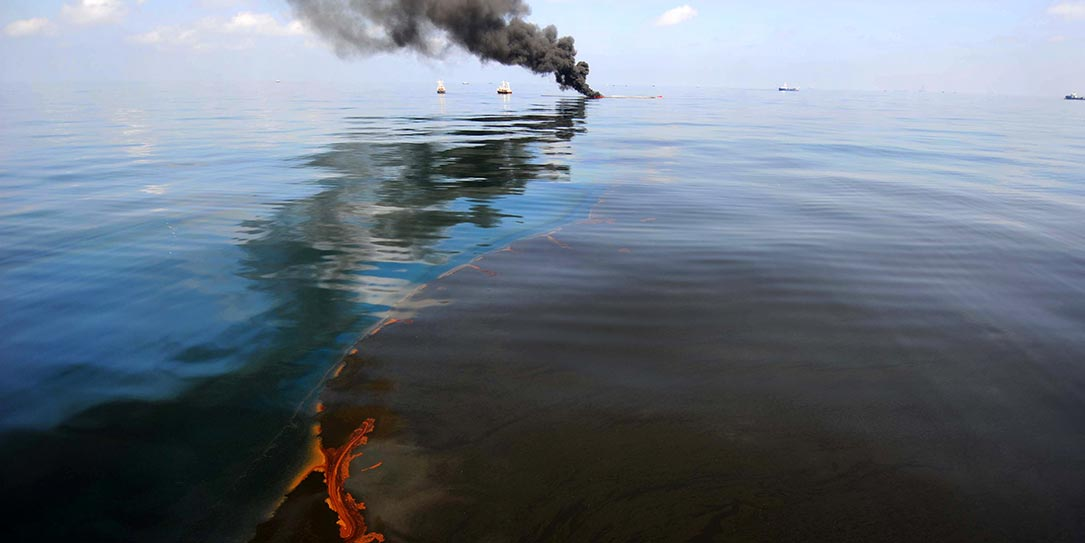 Dark clouds of smoke and fire emerge as oil burns during a controlled fire in the Gulf of Mexico, May 6, 2010.