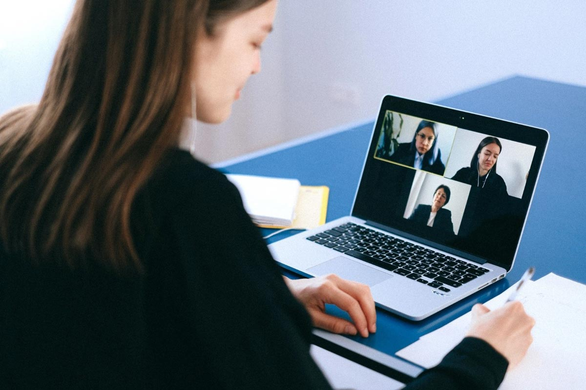 woman on laptop videoconferencing