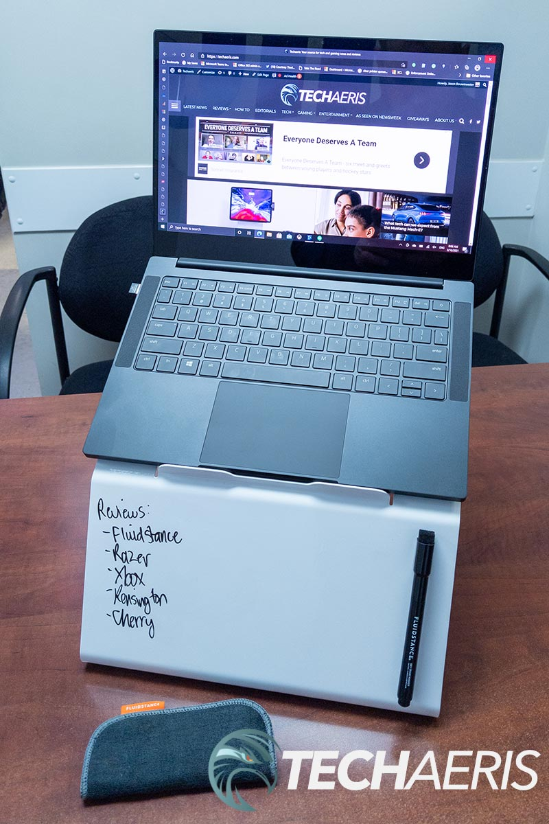 The Fluidstance Lift laptop stand and whiteboard with a 13-inch laptop