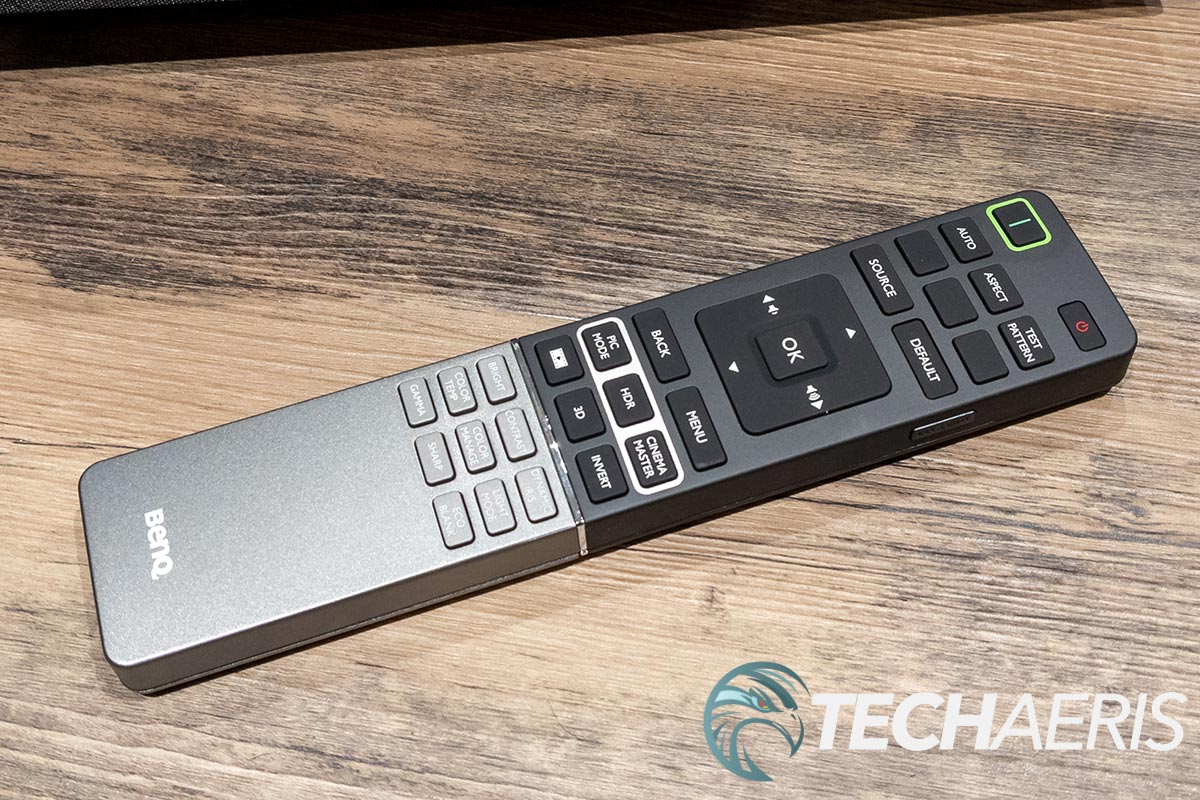The main remote included with the BenQ V7050i 4K UST laser TV projector