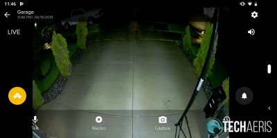 Live view at night with floodlights on and overlay in SAFE by Swann app
