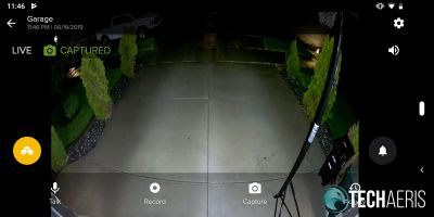 Live view at night with floodlights on and overlay in SAFE by Swann app showing image captured