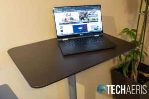 The Seville Classics Airlift XL sit-stand desk cart raised up